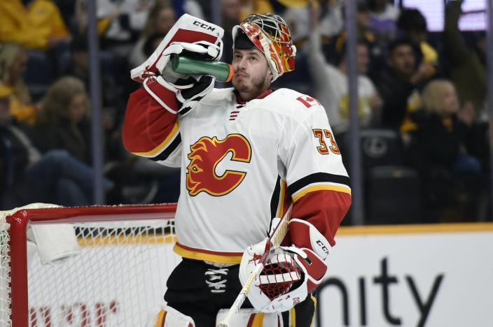 "<span class=""caption"">A Czech-born goaltender for a Canadian hockey team wears a jersey recalling the 1864 burning of Atlanta, Georgia.</span> <span class=""attribution""><a class=""link rapid-noclick-resp"" href=""http://www.apimages.com/metadata/Index/Flames-Predators-Hockey/a0c87ed448414065a8e72a4c6e41fae8/128/0"" rel=""nofollow noopener"" target=""_blank"" data-ylk=""slk:AP Photo/Mark Zaleski"">AP Photo/Mark Zaleski</a></span>"