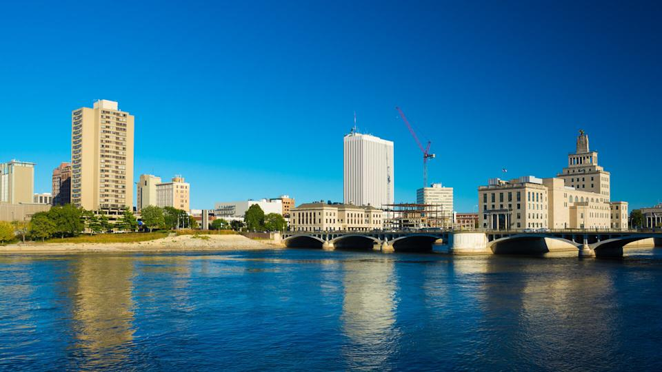 Downtown Cedar Rapids skyline with First Avenue Bridge and Cedar River in the foreground.
