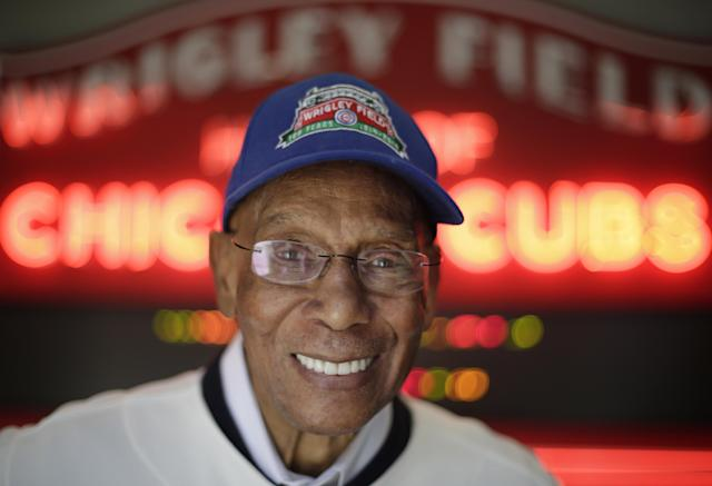 In this March 24, 2014, photo Chicago Cubs' Hall of Famer Ernie Banks smiles after an interview at the Cubs offices in Chicago. (AP Photo/M. Spencer Green)