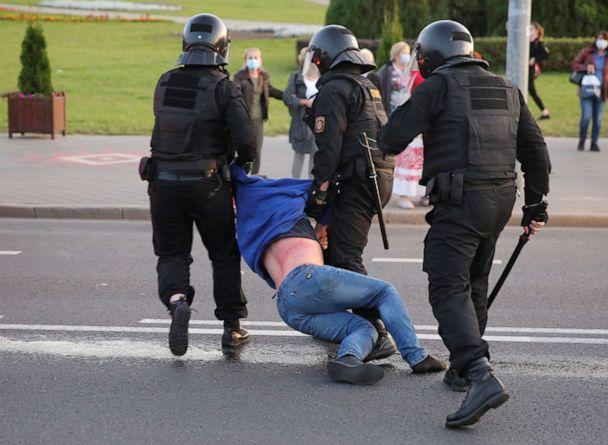 PHOTO: Belarusian law enforcement officers detain a man during an opposition protest against the inauguration of President Alexander Lukashenko in Minsk, Belarus, Sept. 23, 2020. (Tut.by via Reuters)