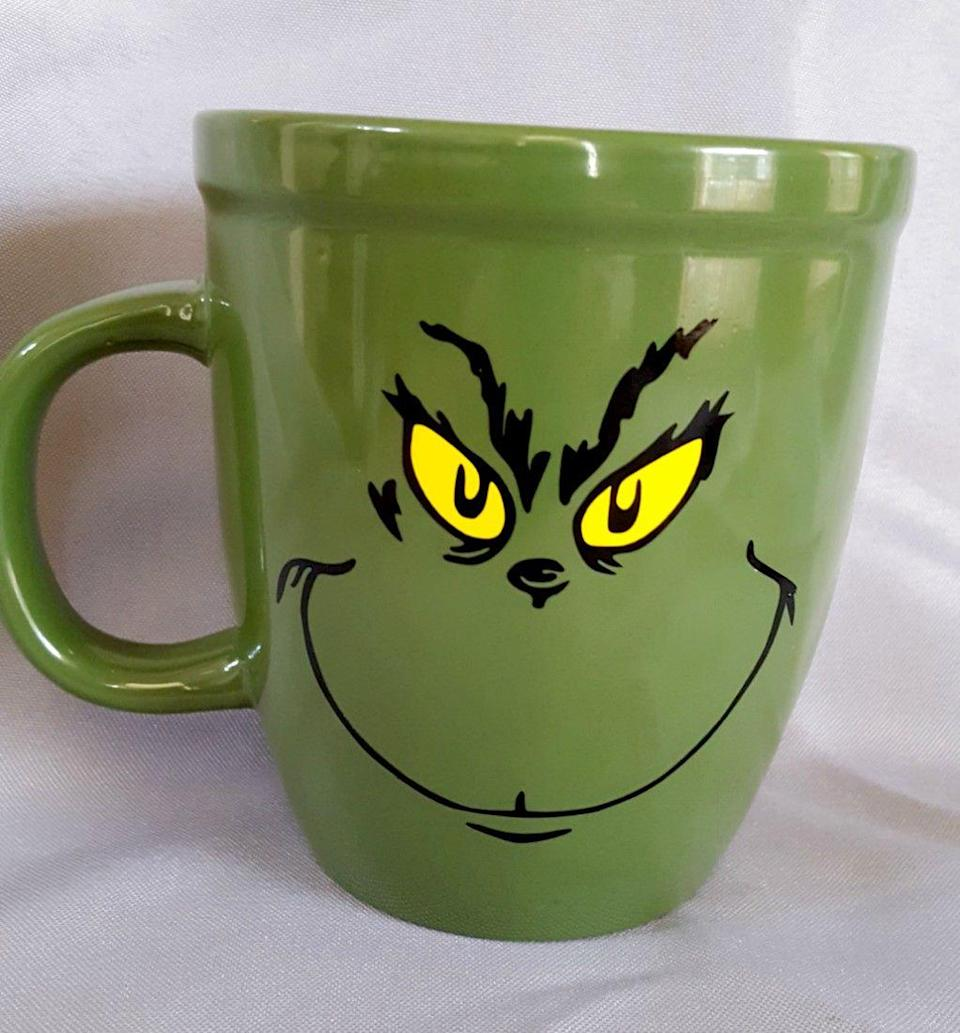 "<p>How cute is this mug? You'll never feel Grinch-y again when you sip your morning coffee out of this! It would make a fun gift, too!</p><p><strong>Get the tutorial at</strong> <a href=""https://leapoffaithcrafting.com/grinch-diy-decorations-and-craft-round-up/"" rel=""nofollow noopener"" target=""_blank"" data-ylk=""slk:Leap of Faith Crafting"" class=""link rapid-noclick-resp"">Leap of Faith Crafting</a>. </p><p><a class=""link rapid-noclick-resp"" href=""https://www.amazon.com/Ounce-Citrus-Green-Coffee-Handle/dp/B07TW54GW9/ref=sr_1_7?dchild=1&keywords=grEEN+MUGS+PLAIN&qid=1603062338&sr=8-7&tag=syn-yahoo-20&ascsubtag=%5Bartid%7C10050.g.28982778%5Bsrc%7Cyahoo-us"" rel=""nofollow noopener"" target=""_blank"" data-ylk=""slk:SHOP GREEN MUGS"">SHOP GREEN MUGS</a></p>"