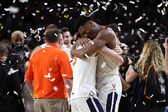 De'Andre Hunter #12 and Kyle Guy #5 of the Virginia Cavaliers celebrate their teams 85-77 win over the Texas Tech Red Raiders to win the the 2019 NCAA men's Final Four National Championship game at U.S. Bank Stadium on April 08, 2019 in Minneapolis, Minnesota. (Photo by Streeter Lecka/Getty Images)