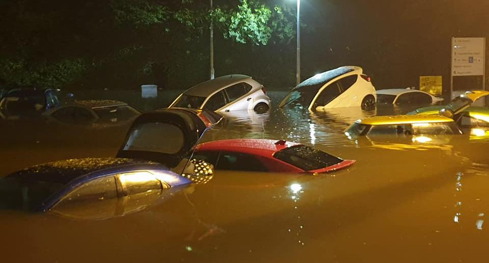 Dozens of cars pictured in flood waters outside Scotland's Victoria Hospital.