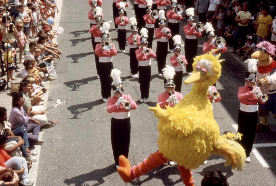 Big Bird leads a marching band