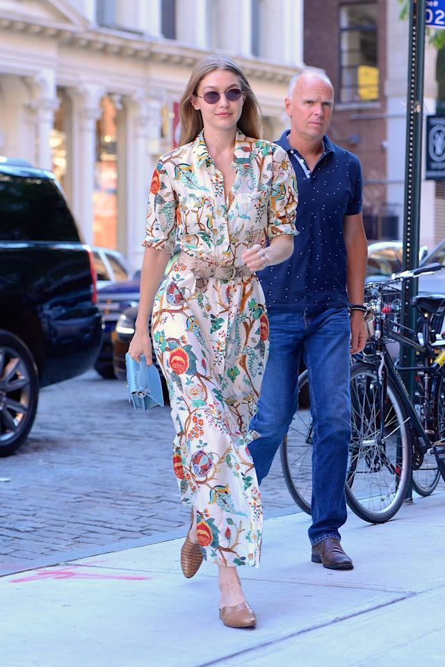 <p>The model looked summer-ready in NYC with a floral dress by Alberta Ferretti. She complemented the look with croc-embossed mules from Freda Salvador, a Paula Cademartori bag, a Streets Ahead belt, and Oliver Peoples sunglasses.</p>