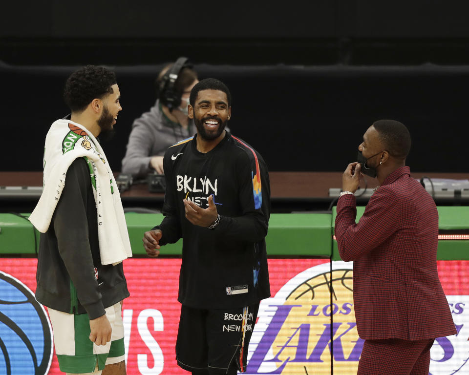 Brooklyn's Kyrie Irving is just one problem facing Boston's Jayson Tatum and Kemba Walker. (Omar Rawlings/Getty Images)