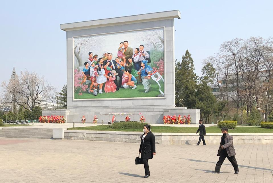 People walk past a mosaic depicting supreme North Korean leaders Kim Il-sung and Kim Jong-il in eastern Pyongyang. Source: AAP