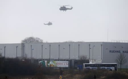 Helicopters with French intervention forces hover above the scene of a hostage taking at an industrial zone in Dammartin-en-Goele, northeast of Paris January 9, 2015. REUTERS/Pascal Rossignol