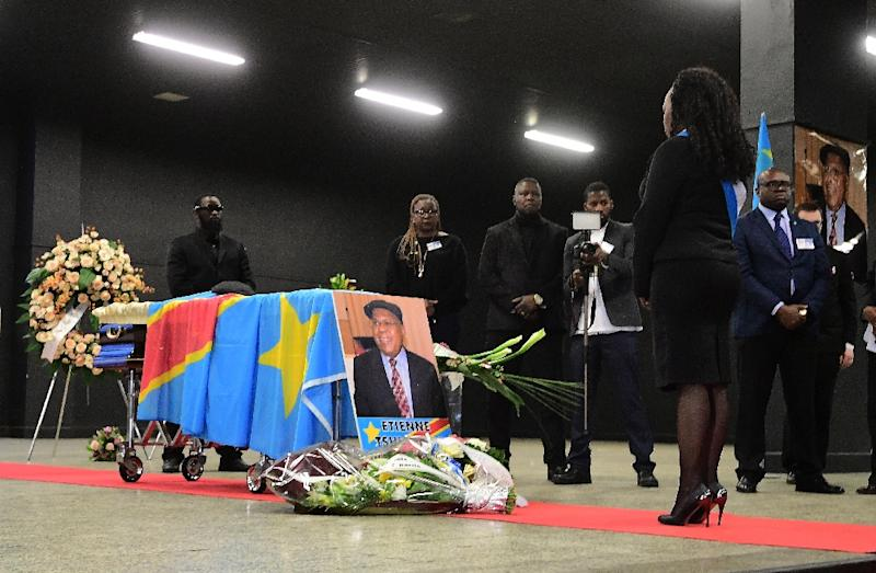 A woman stands in front of the coffin of Democratic Republic of Congo's opposition leader Etienne Tshisekedi during a funeral wake in his honour, in Brussels on February 5, 2017 (AFP Photo/EMMANUEL DUNAND)