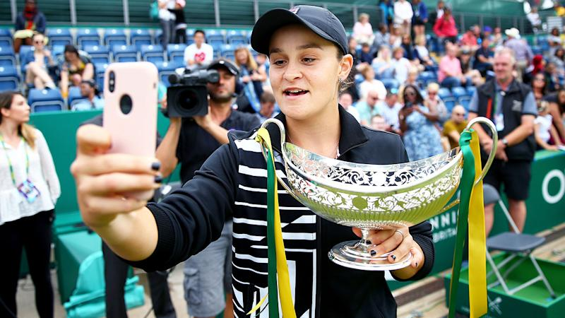 Ashleigh Barty of Australia takes a selfie with the Maud Watson Trophy after victory in her final match of the Nature Valley Classic. (Photo by Jordan Mansfield/Getty Images for LTA)