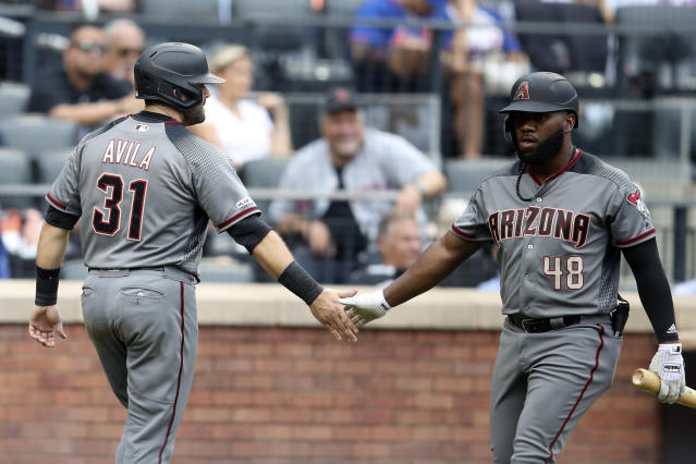 Arizona Diamondbacks' Alex Avila (31) celebrates with Abraham Almonte (48) after scoring off an RBI-double by Ildemaro Vargas during the seventh inning of a baseball game against the New York Mets, Thursday, Sept. 12, 2019, in New York. (AP Photo/Mary Altaffer)