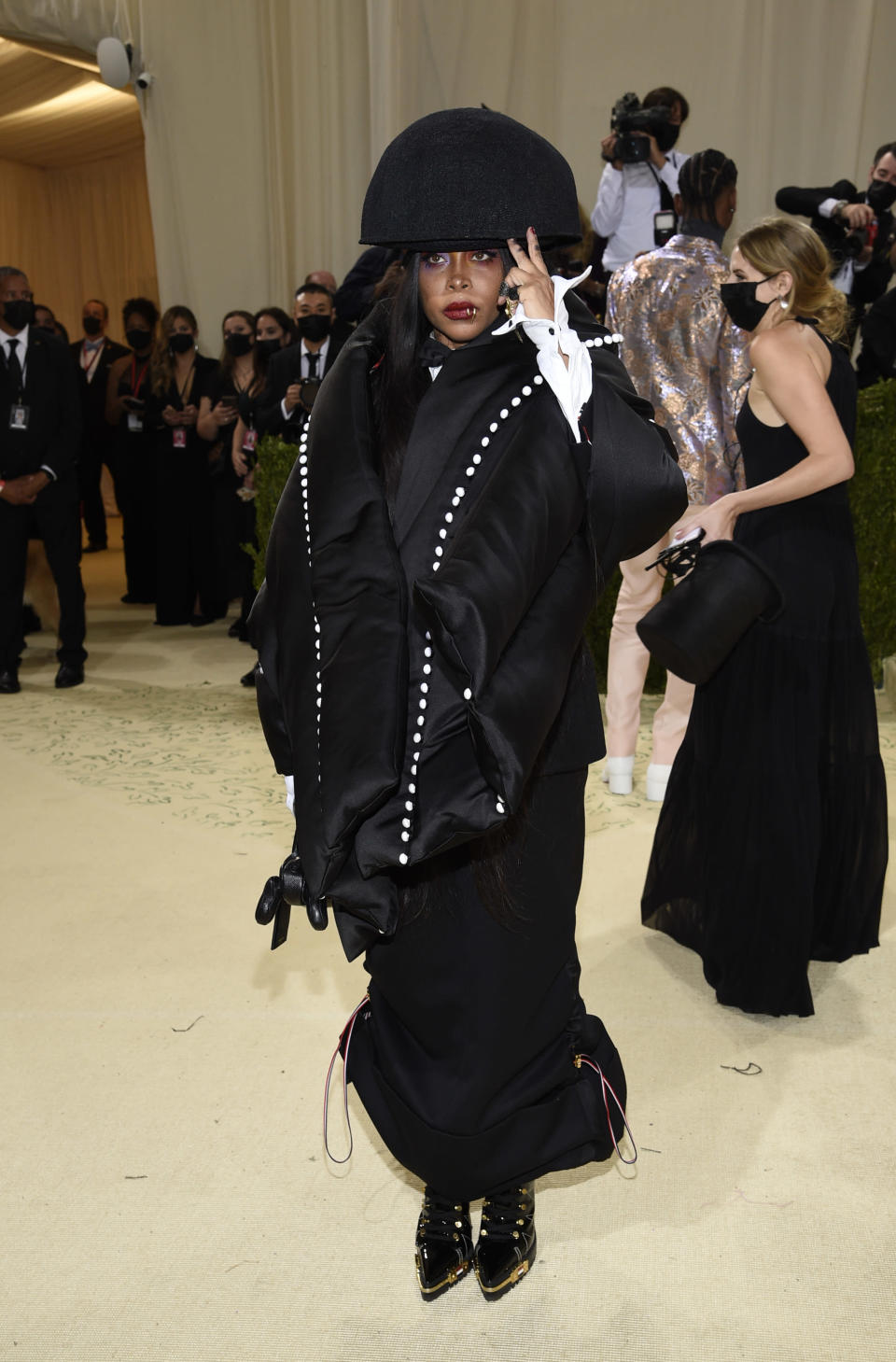 """Erykah Badu attends The Metropolitan Museum of Art's Costume Institute benefit gala celebrating the opening of the """"In America: A Lexicon of Fashion"""" exhibition on Monday, Sept. 13, 2021, in New York. (Photo by Evan Agostini/Invision/AP)"""