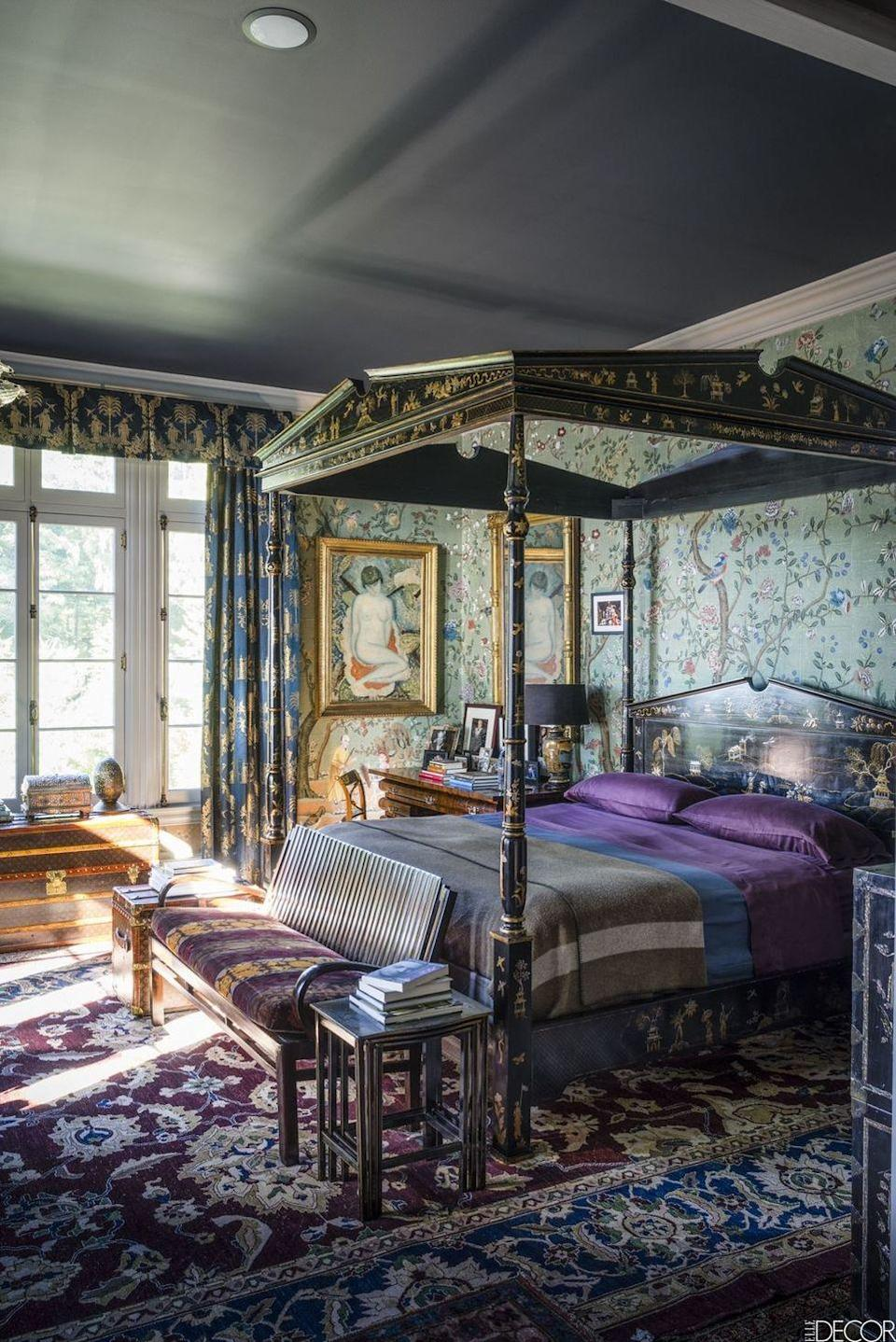 """<p>On an <a href=""""https://www.elledecor.com/design-decorate/house-interiors/a8979/ferncliffe-estate/"""" rel=""""nofollow noopener"""" target=""""_blank"""" data-ylk=""""slk:estate in the Hudson River Valley"""" class=""""link rapid-noclick-resp"""">estate in the Hudson River Valley</a>, the pattern-friendly master bedroom is outfitted with hand-painted wallpaper by de Gournay. The curtains and pelmet are of Lelievre damasks, and the rug is a Persian 20th-century design.</p><p><em>Jenny Peopy Wallpaper, from $18<br></em><a class=""""link rapid-noclick-resp"""" href=""""https://www.spoonflower.com/en/wallpaper/7195938-jenny-peony-cornflower-by-domesticate?country=us¤cy=USD&fabric=wallpaper_smooth&measurement_system=imperial&size=WALLPAPER_IMPERIAL_ROLL_2_x_3&gclid=CjwKCAiArIH_BRB2EiwALfbH1K39qZlspGSzqiXZumPhZnnecu6XnMNOryG29H1bJtXgljNOX4KzjxoC_nAQAvD_BwE"""" rel=""""nofollow noopener"""" target=""""_blank"""" data-ylk=""""slk:Shop the Look"""">Shop the Look</a></p>"""