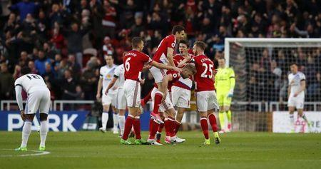 Britain Soccer Football - Middlesbrough v Sunderland - Premier League - The Riverside Stadium - 26/4/17 Middlesbrough's Marten de Roon celebrates scoring their first goal with Adam Clayton and team mates Reuters / Phil Noble Livepic