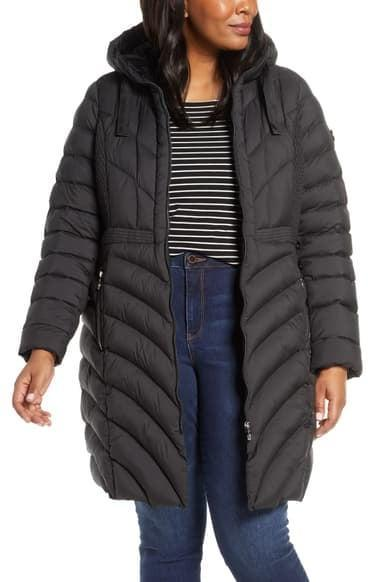 <p>You can't go wrong with this <span>Bernardo Packable Hooded Walker Coat</span> ($225).</p>