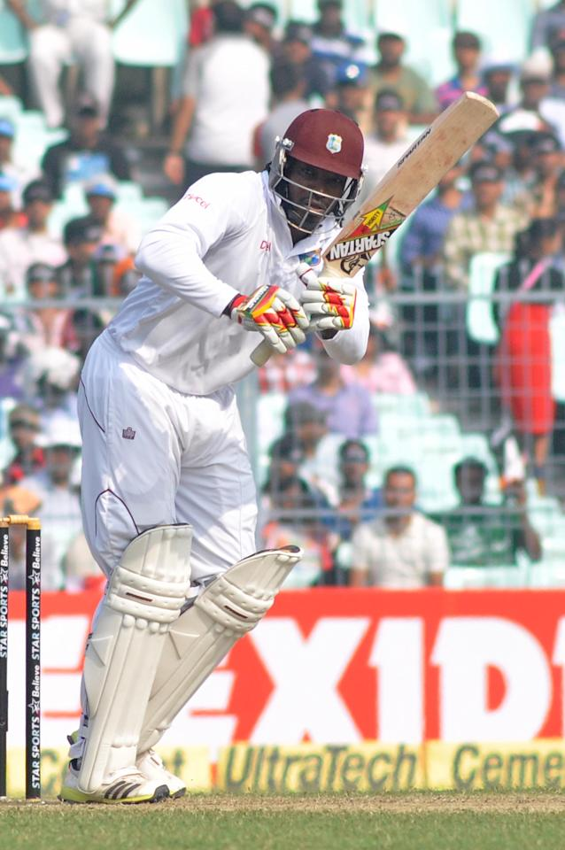 West Indies batsman Chris Gayle in action during the 1st day of the 1st test match between India and West Indies at Eden Gardens, Kolkata on Nov. 6, 2013. (Photo: IANS)