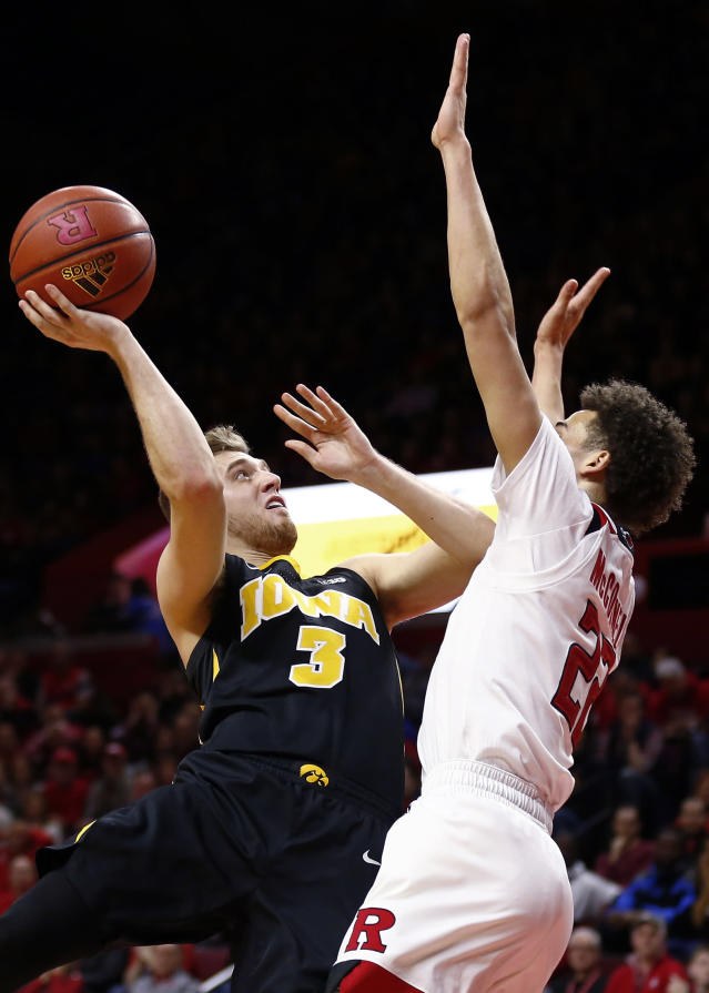 Iowa guard Jordan Bohannon (3) shoots over Rutgers guard Caleb McConnell during the second half of an NCAA college basketball game Saturday, Feb. 16, 2019, in Piscataway, N.J. Iowa won 71-69. (AP Photo/Adam Hunger)