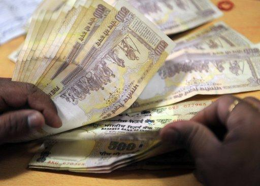 India's rupee slumped to as low as 56.38 to the dollar last week