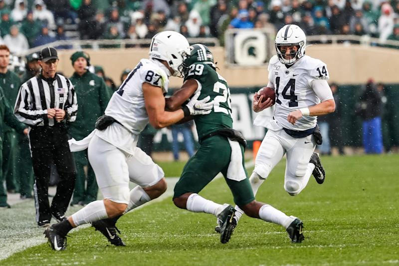 Penn State quarterback Sean Clifford keeps the ball for a run against Michigan State during the first half at Spartan Stadium in East Lansing, Saturday, October 26, 2019.