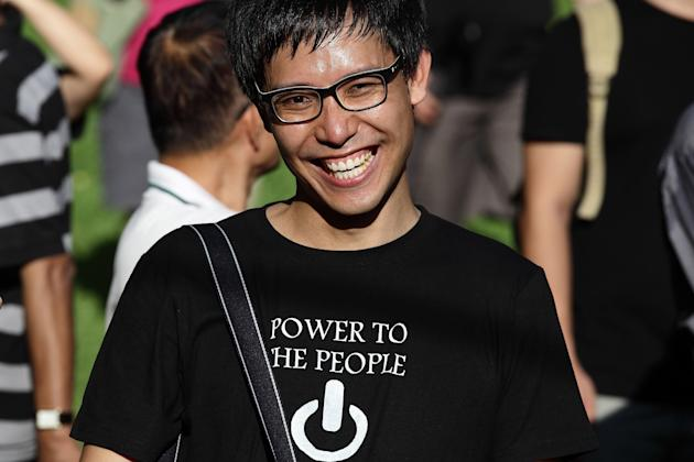 SINGAPORE - JUNE 07: Roy Ngerng is seen during the 'Return Our CPF' protest at the Speakers' Corner at Hong Lim Park on June 7, 2014 in Singapore. Roy Ngerng is locked in a legal dispute with the Prime Minister of Singapore about an alleged defamatory article on the Singaporeans' CPF saving posted by Roy. Through crowd funding, Roy has managed to raise more than $90,000 for his legal defence fund within a week. The protest was staged to demand greater transparency and accountability from the government on how the CPF monies are being utilized. (Photo by Suhaimi Abdullah/Getty Images)