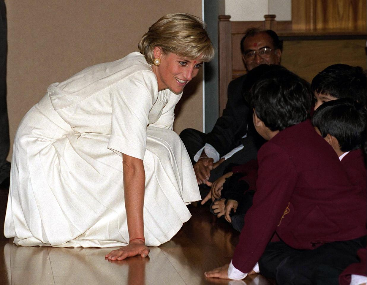 """<p>On public engagements, it had always been customary for the royal family to process through the crowds without stopping, until the queen introduced the royal walkabout on a tour of Australia and New Zealand in 1970. It was Princess Diana, however, who took things to another level as she waded into crowds with her hand outstretched, welcoming hugs and crouching down on the floor to chat with children to create a feeling of intimacy and empathy. One of the <a href=""""https://www.popsugar.co.uk/celebrity/Princess-Diana-Family-Traditions-40146520"""" target=""""_blank"""" class=""""ga-track"""" data-ga-category=""""Related"""" data-ga-label=""""https://www.popsugar.com/celebrity/Princess-Diana-Family-Traditions-40146520"""" data-ga-action=""""In-Line Links"""">many traditions</a> that William and Harry have inherited from their mother is this trait, often revealing little tidbits of information about their family or personal lives along the way.</p>     <p>Related: <a href=""""https://www.popsugar.com/celebrity/British-Royal-Family-Breaking-Protocol-43690330?utm_medium=partner_feed&utm_source=yahoo_publisher&utm_campaign=related%20link"""">10 Times the British Royal Family Showed Us That Some Rules Are Meant to Be Broken</a></p>"""