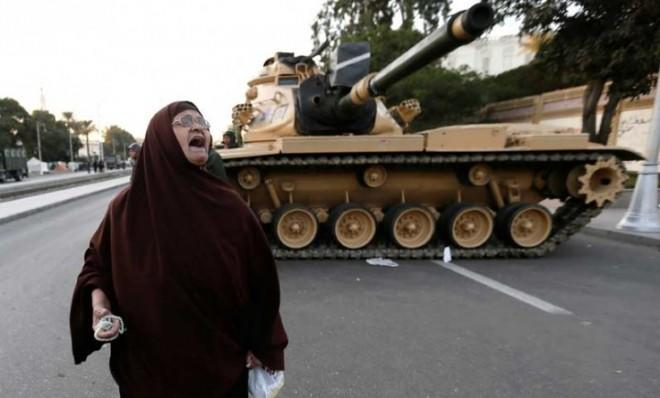An Egyptian protester chants slogans against President Morsi outside the presidential palace in Cairo on Dec. 18.