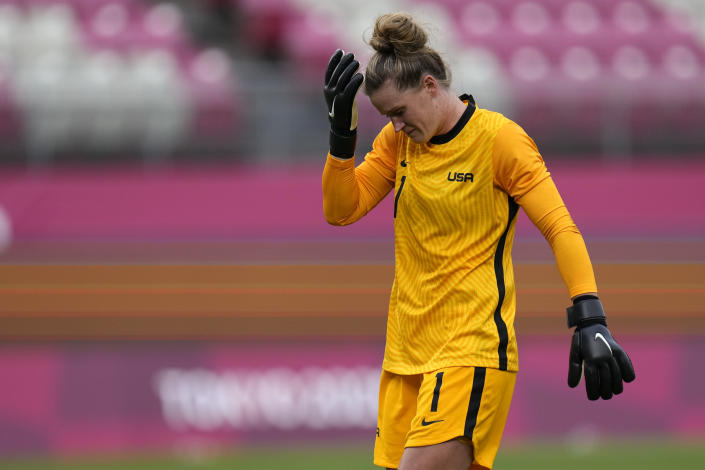United States' goalkeeper Alyssa Naeher leaves the field after being injured during a women's semifinal soccer match against Canada at the 2020 Summer Olympics, Monday, Aug. 2, 2021, in Kashima, Japan. (AP Photo/Fernando Vergara)