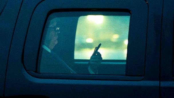 PHOTO: President Donald Trump, with reading glasses, looks at his cellphone as he departs the White House for a campaign trip to Milwaukee, Jan. 14, 2020. (New York Times via Redux Pictures, FILE)