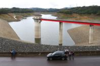 Tourists visit the Baoshan second reservoir amid low water levels during an islandwide drought, in Hsinchu, Taiwan