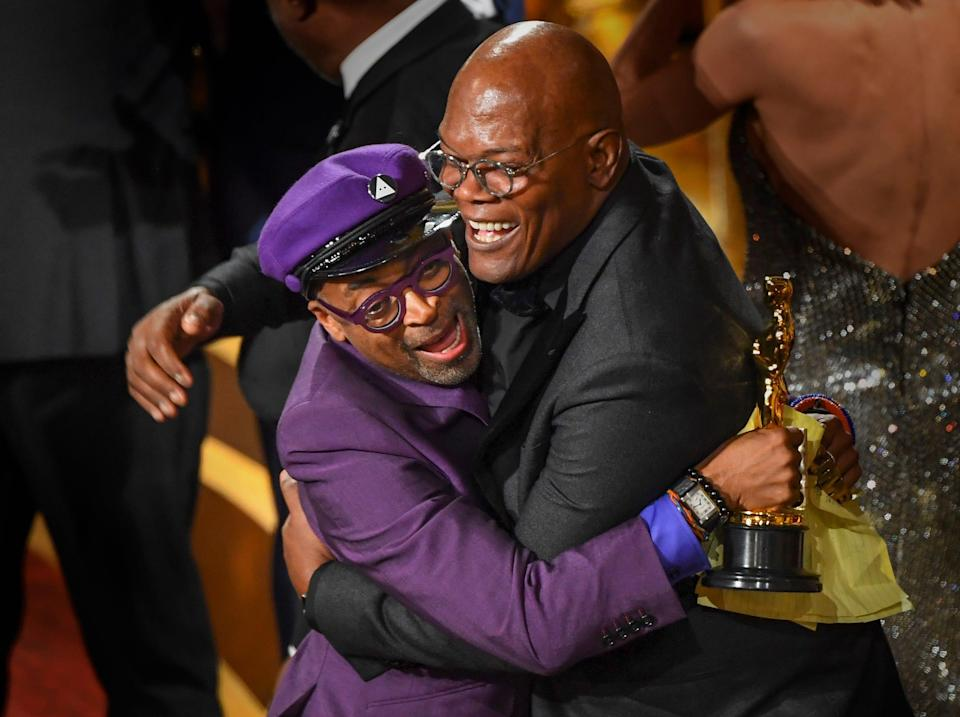 """""""BlacKkKlansman"""" director Spike Lee, getting hugs from presenter Samuel L. Jackson as he took home his first Oscar at the 2019 Academy Awards, following five nominations in nearly 30 years."""