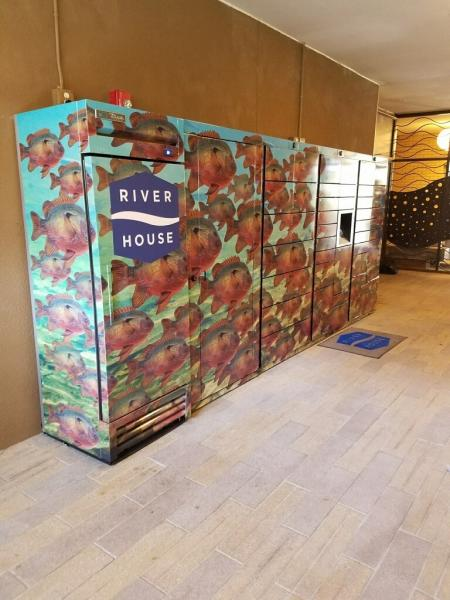 This photo provided by Luxer One shows one of Luxer's access lockers for packages and refrigerated systems for perishable deliveries at River House Apartments in San Antonio, Texas. Luxer One provides secure lockers in buildings in the United States and Canada that can be accessed by both delivery companies and residents.(Luxer One via AP)