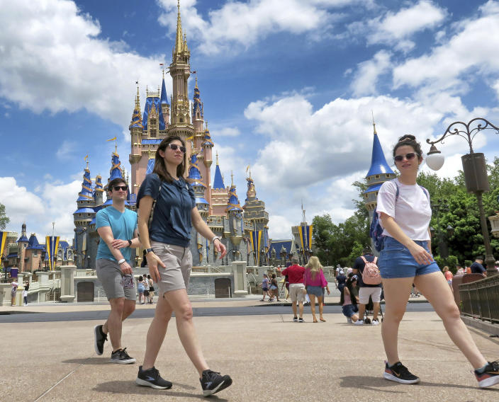 Young fans enjoy seeing Winnie The Pooh, and Tigger too, at the Magic Kingdom at Walt Disney World, in Lake Buena Vista, Fla., Monday, May 17, 2021, after Disney Co. eased face mask requirements over the weekend. Guests are allowed to go maskless in outdoor areas of the parks. Indoor attractions, shops and Disney transportation at the resort all still require masks. (Joe Burbank/Orlando Sentinel via AP)