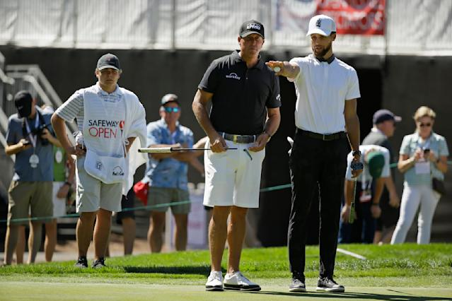 Stephen Curry, right, and Phil Mickelson look over the seventh green of the Silverado Resort North Course during the pro-am event of the Safeway Open PGA golf tournament Wednesday, Sept. 25, 2019, in Napa, Calif. (AP Photo/Eric Risberg)