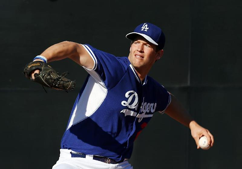 Los Angeles Dodgers' Clayton Kershaw pitches during spring training baseball practice Sunday, Feb. 9, 2014, in Glendale, Ariz
