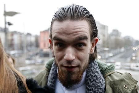 """Michael Delefortrie, who is suspected of being part of """"Sharia4Belgium"""", arrives for the verdict in the trial of the group in Antwerp February 11, 2015. REUTERS/Francois Lenoir"""