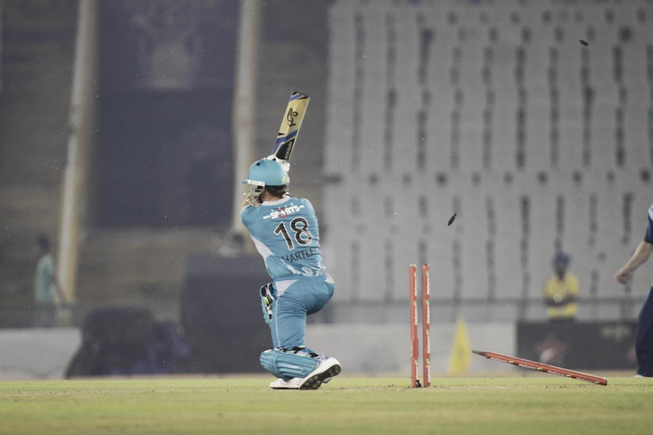 C D Hartley of Brisbane Heat gets bowled during the Champions League T20, 6th match, Group B, between Brisbane Heat and Titans at Mohali stadium, Chandigarh  on Sept. 24, 2013. (Photo: IANS)