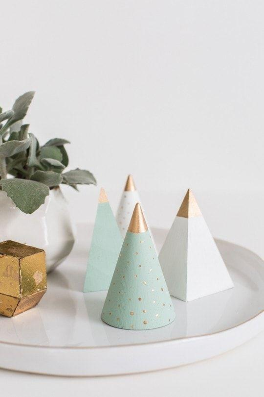 """<p>This mini Christmas tree craft couldn't be easier to make; you might even want to make a whole forest of them! Use laser cut wooden shapes from the craft supply store, and paint them with decorative touches in gold for extra fanciness.</p><p><em><a href=""""https://sugarandcloth.com/diy-mini-wooden-christmas-trees/"""" rel=""""nofollow noopener"""" target=""""_blank"""" data-ylk=""""slk:Get the tutorial at Sugar and Cloth"""" class=""""link rapid-noclick-resp"""">Get the tutorial at Sugar and Cloth </a></em></p>"""