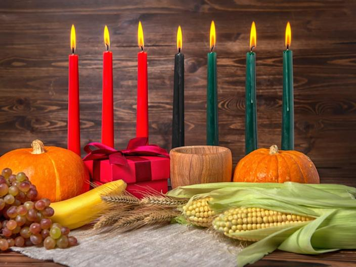 """<span class=""""caption"""">A candle is lit each day to celebrate the seven basic values of African culture.</span> <span class=""""attribution""""><a class=""""link rapid-noclick-resp"""" href=""""https://www.shutterstock.com/image-photo/kwanzaa-holiday-concept-decorate-seven-candles-703147627?src=VdfiHqNwle82YCsFWIQaHQ-1-2"""" rel=""""nofollow noopener"""" target=""""_blank"""" data-ylk=""""slk:Ailisa via Shutterstock.com"""">Ailisa via Shutterstock.com</a></span>"""