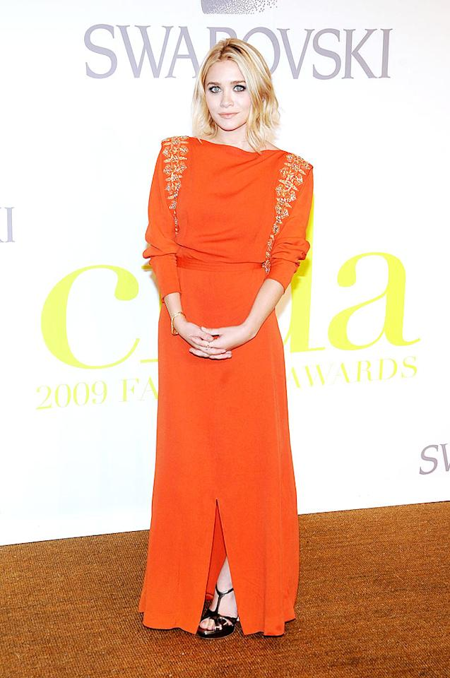 """Ashley Olsen struck a pose in her signature scowl and a vintage orange gown with gold leaf embroidery upon arriving at NYC's Lincoln Center for the 2009 CFDA Fashion Awards. Jamie McCarthy/<a href=""""http://www.wireimage.com"""" target=""""new"""">WireImage.com</a> - June 15, 2009"""