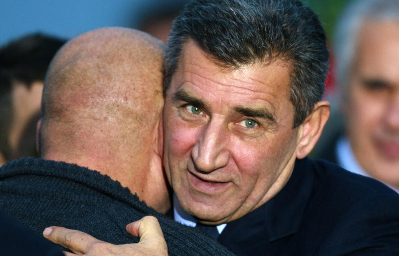 Croatian Gen. Ante Gotovina, right, is embraced by an unidentified Croatian war veteran upon his arrival to the airport in Zagreb, Croatia, Friday, Nov. 16, 2012. The Yugoslav war crimes tribunal overturned the convictions of two Croat generals including Gotovina on Friday for murdering and illegally expelling Serb civilians in a 1995 military blitz, and ordered both men to be freed immediately. (AP Photo/Nikola Solic)