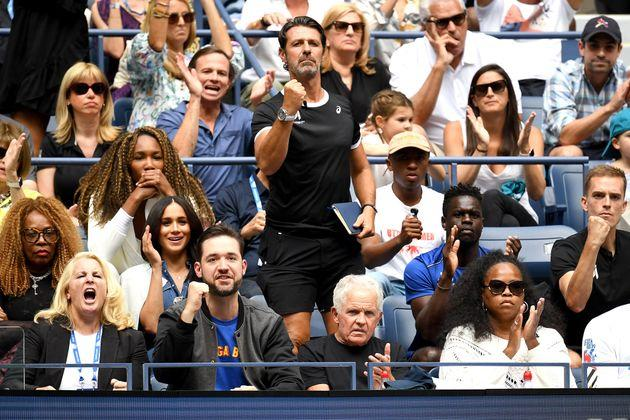 Venus Williams, coach Patrick Mouratoglou, husband Alexis Ohanian, and Meghan, Duchess of Sussex, cheer for Serena Williams.