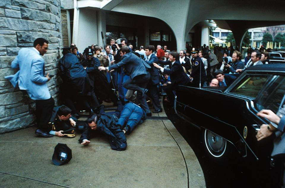 John Hinckley Jr is tackled to the ground by Secret Service agents after attempting to assassinate Ronald ReaganZuma/Shutterstock