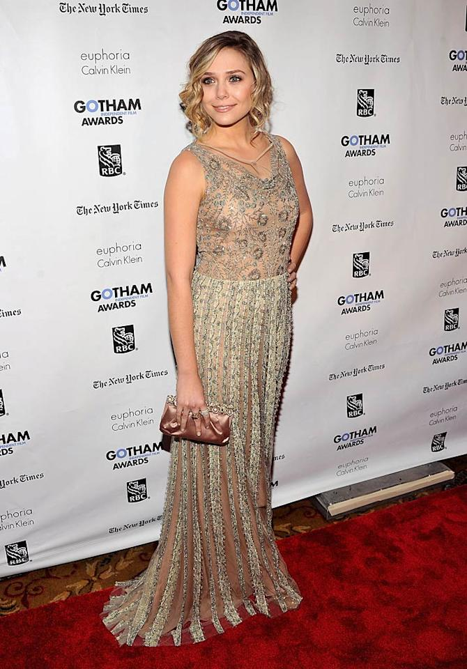 Also looking stunning at the Gotham Independent Film Awards was Elizabeth Olsen, who donned a beautiful embroidered Valentino gown and soft curls for the occasion. Fortunately, Elizabeth doesn't always turn to her big sisters Ashley and Mary-Kate for style advice! (11/28/2011)