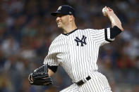 New York Yankees pitcher J.A. Happ delivers during the first inning of a baseball game against the Boston Red Sox, Sunday, Aug. 4, 2019, in New York. (AP Photo/Adam Hunger)