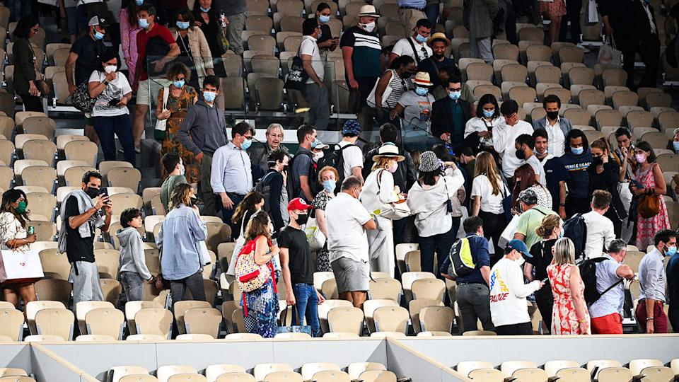 Members of the crowd, pictured here leaving Court Philippe Chatrier during Novak Djokovic's clash with Matteo Berrettini.