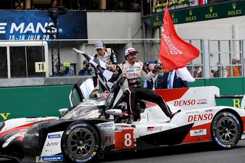 Alonso and Buemi on board their winning Toyota with Nakajima behind the wheel (AFP Photo/Fred TANNEAU)