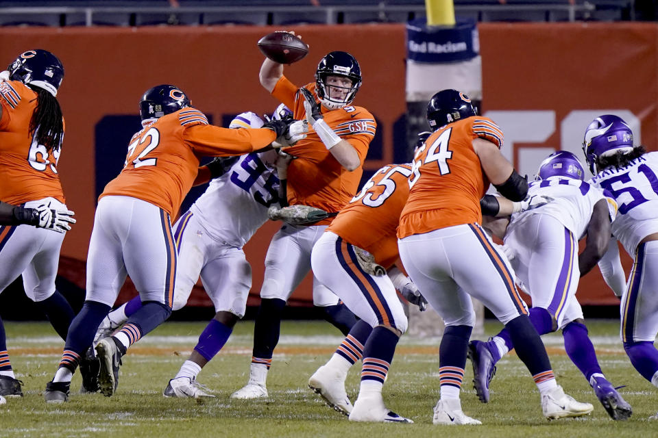 Chicago Bears quarterback Nick Foles is hit by Minnesota Vikings defensive end Ifeadi Odenigbo (95) during the second half of an NFL football game Monday, Nov. 16, 2020, in Chicago. Foles was injured on the play and left the game on a cart. (AP Photo/Nam Y. Huh)