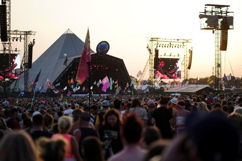 The sun sets behind the Pyramid stage during Glastonbury Festival in Somerset