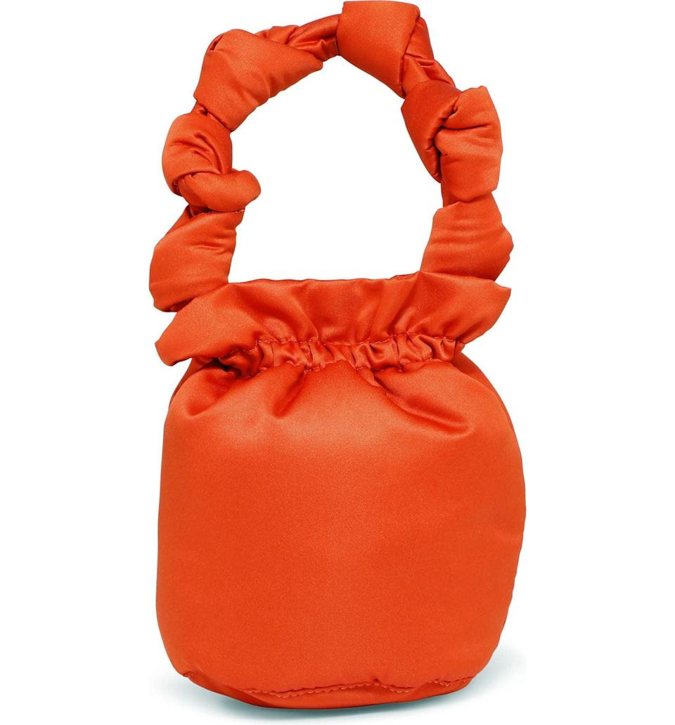 <p>This <span>Ganni Satin Knots Bucket Bag</span> ($115) isn't your average bucket bag, but we wouldn't have it any other way. The knotted strap adds to the unique look, and it's crafted from a recycled-polyester blend that makes it sustainable.</p>