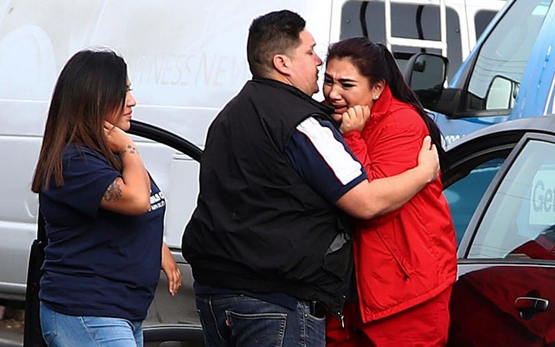 Fernando Juarez, 36, of Napa, center, embraces his 22-year-old sister Vanessa Flores, right, at the Veterans Home of California - AP